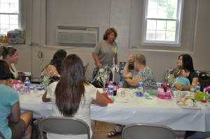 MIHOW Sandra Justice explains the proper use of a car seat at a baby safety shower.